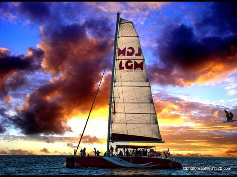 Enjoy the magic of the sunset during a mini cruise on the catamaran